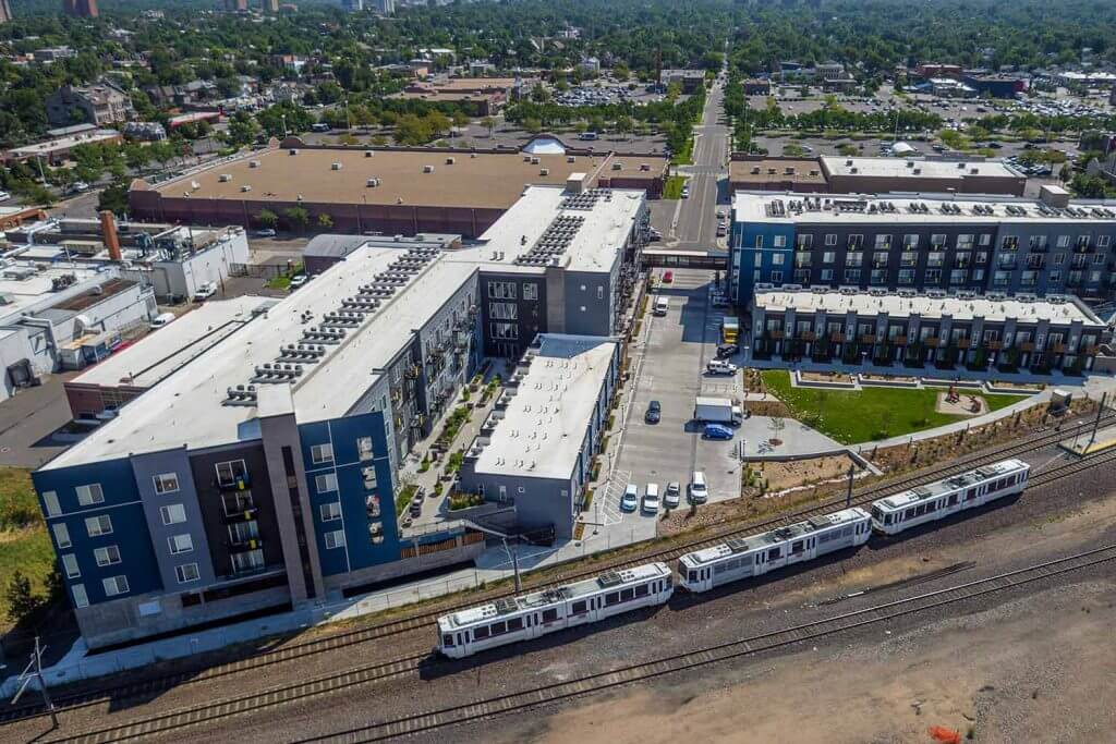Arial view of Denizen Apartments with Light Rail